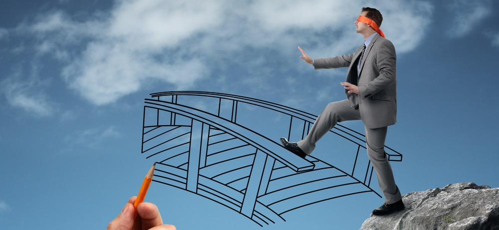 a person, symbolizing a high risk business, is about to cross an imaginary bridge.